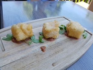 Three pieces of beer battered brie cheese